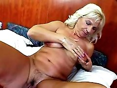 Blonde granny plays with huge dildo