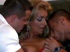 Elder mature sucks two cocks