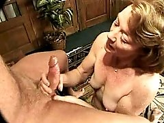 Busty milf sucks cock with pleasure